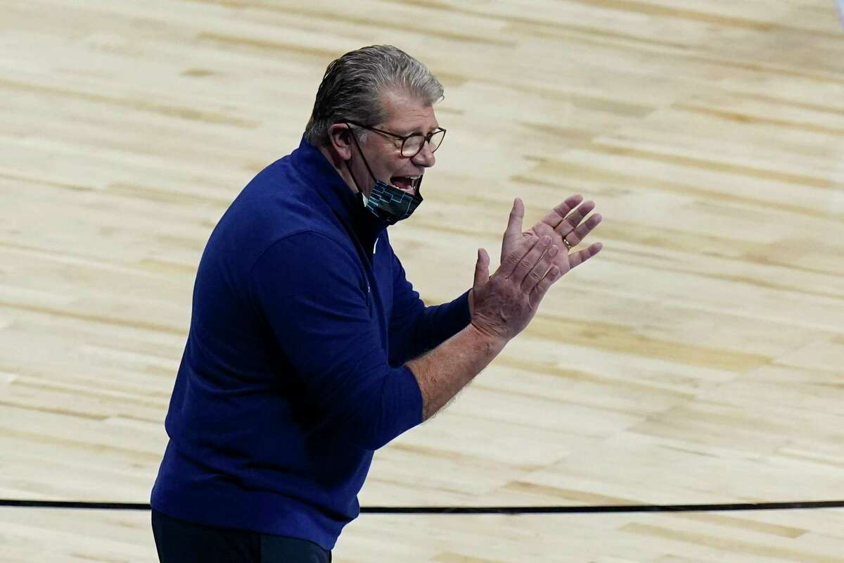 UConn head coach Geno Auriemma talks to displayers during the second half of a college basketball game against Iowa in the Sweet Sixteen round of the women's NCAA tournament at the Alamodome in San Antonio, Saturday, March 27, 2021. (AP Photo/Eric Gay)