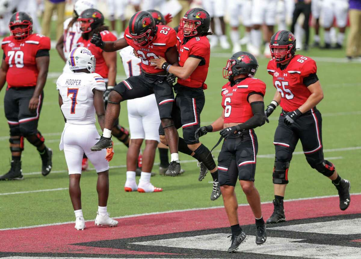 Lamar's Kirkland Banks (23) celebrates with his teammates during the Cardinals' win over Northwestern State Saturday in Beaumont.