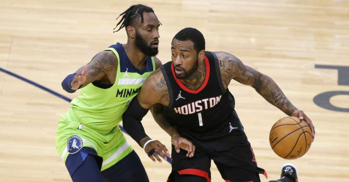 Houston Rockets guard John Wall (1) drives on Minnesota Timberwolves guard Jaylen Nowell (4) during the first half of an NBA basketball game Saturday, March 27, 2021, in Minneapolis. (AP Photo/Andy Clayton-King)