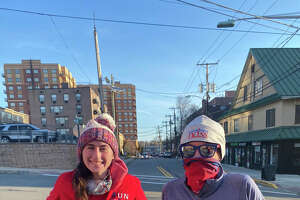 """Jamie Durant, left, and her partner Gina Mannion, getting ready to run their first leg in Fort Lee, New Jersey, as part of """"Run for 3.21"""" National Down Syndrome Society team on Friday, March 19, 2021. The group ran a 260-mile relay from New York City to Washington D.C. , raising $90,000 so far for the organization. (Provided)"""