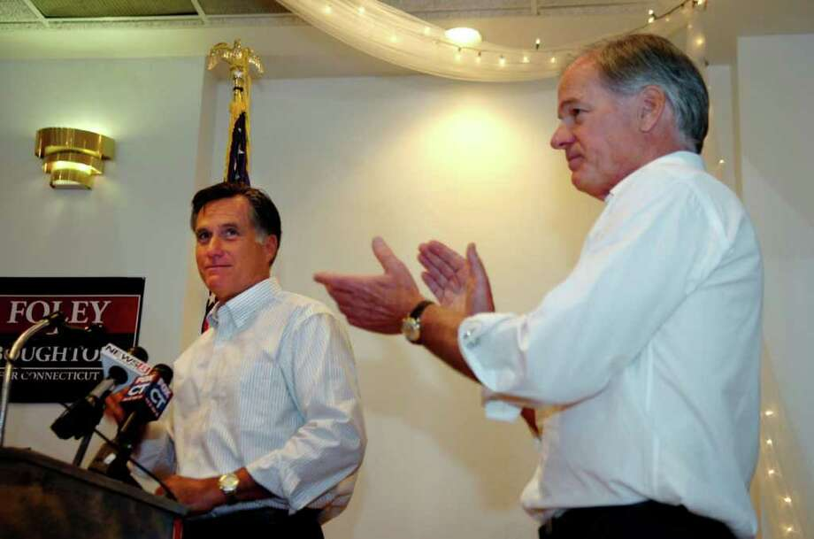 Former Massachusetts Gov. Mitt Romney, left, speaks in support of Republican candidate for Connecticut governor Tom Foley, right, at a political rally in downtown Greenwich, on Thursday, Sept. 9, 2010. Photo: Helen Neafsey / Greenwich Time