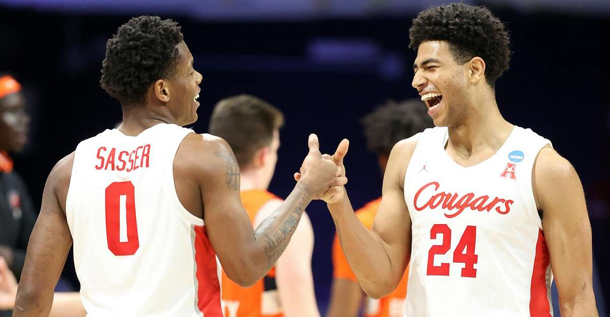 Marcus Sasser #0 and Quentin Grimes #24 of the Houston Cougars react in the second half of their Sweet Sixteen game against the Syracuse Orange in the 2021 NCAA Men's Basketball Tournament at Hinkle Fieldhouse on March 27, 2021 in Indianapolis, Indiana. (Photo by Andy Lyons/Getty Images)
