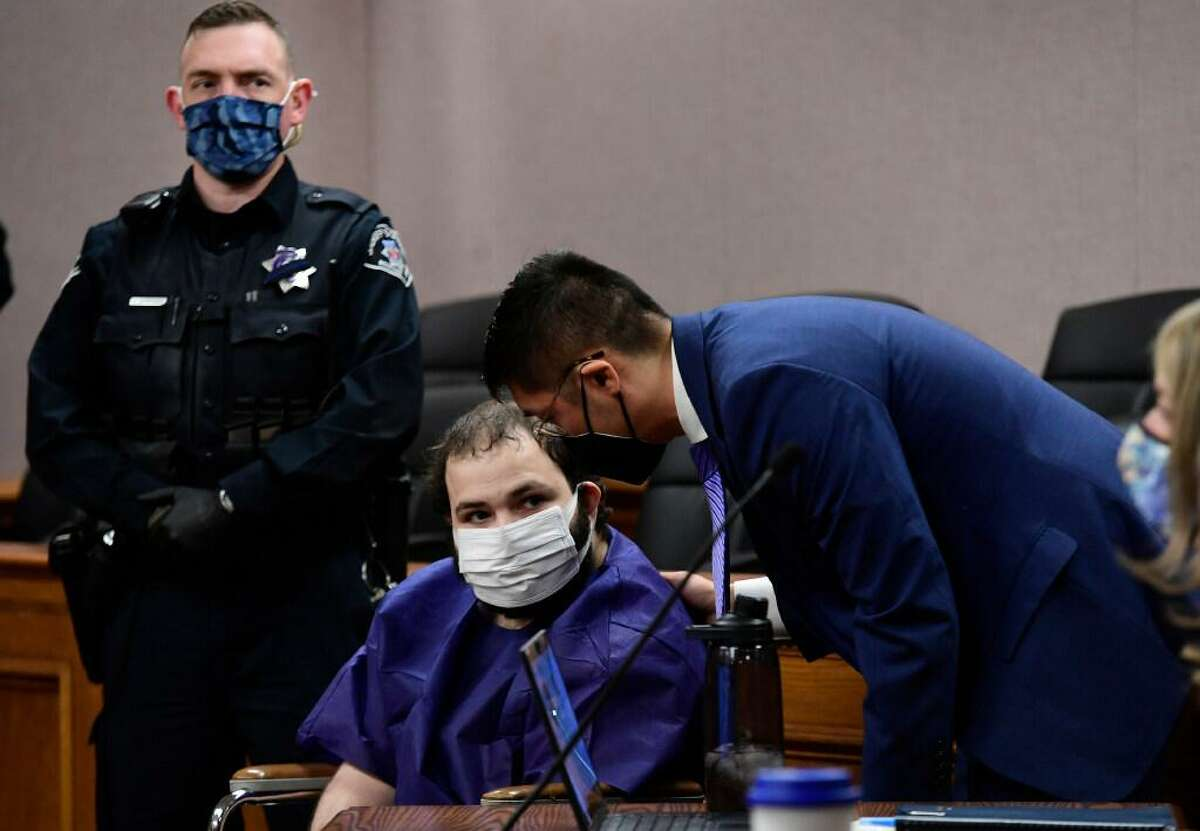 """Ahmad Al Aliwi Alissa, 21, appears before Boulder District Court Judge Thomas Mulvahill at the Boulder County Justice Center in Boulder, Colo. on March 25, 2021. Three days after he was led away in handcuffs from a Boulder supermarket where 10 people were fatally shot, Alissa appeared in court for the first time and his defense lawyer asked for a mental health assessment """"to address his mental illness."""""""