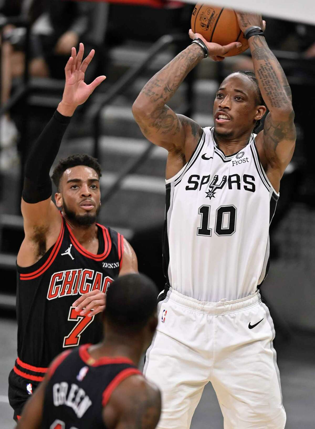 San Antonio Spurs' DeMar DeRozan (10) shoots as he is defended by Chicago Bulls' Troy Brown, Jr. during the second half of an NBA basketball game on Saturday, March 27, 2021, in San Antonio. (AP Photo/Darren Abate)
