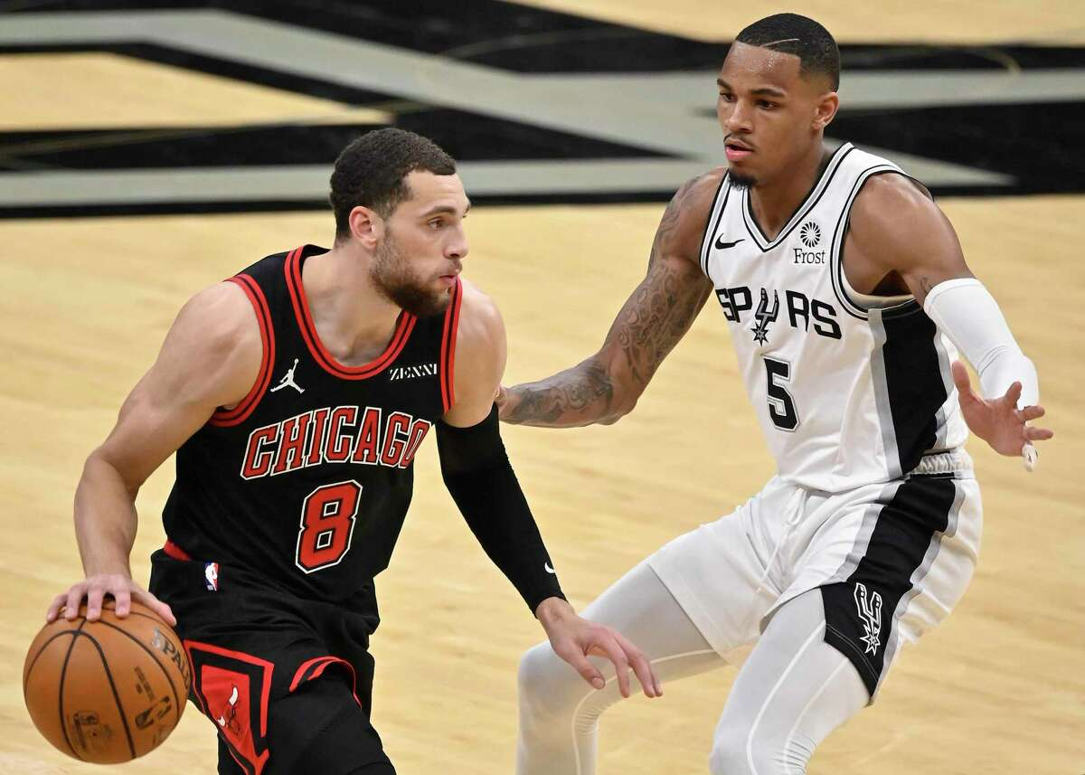 Chicago Bulls' Zach LaVine (8) drives against San Antonio Spurs' Dejounte Murray during the first half of an NBA basketball game on Saturday, March 27, 2021, in San Antonio. (AP Photo/Darren Abate)