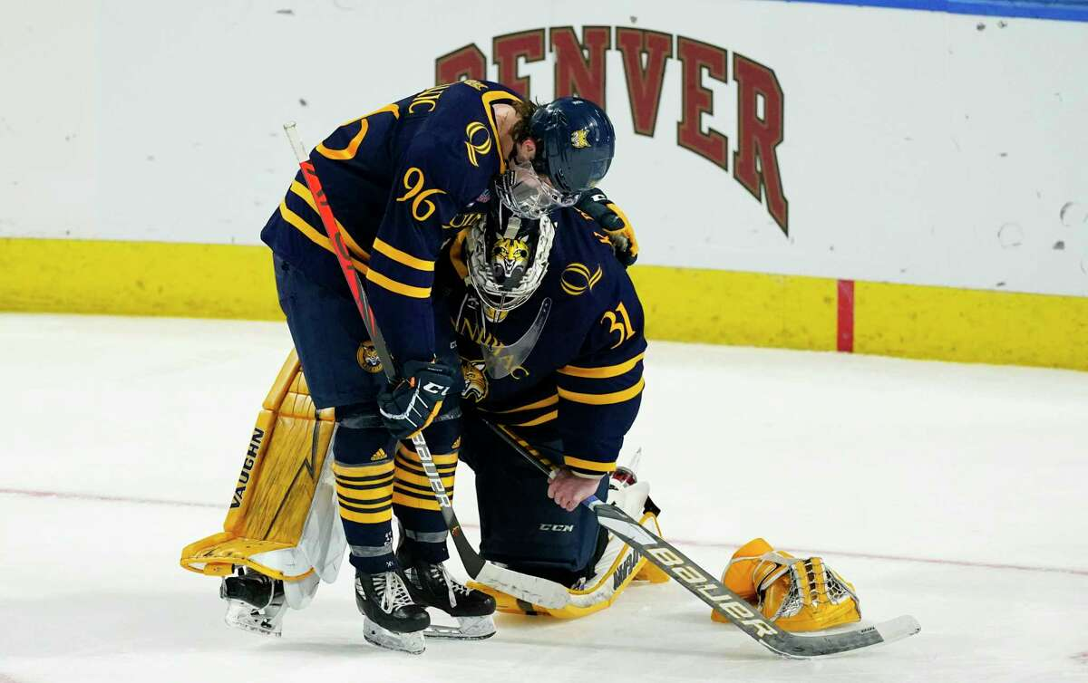 Quinnipiac forward Ty Smilanic, left, consoles goaltender Keith Petruzzelli after their loss to Minnesota State in an NCAA West Regional semifinal March 27.