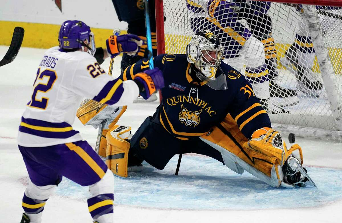 Minnesota State forward Dallas Gerads, left, reacts as a shot by forward Cade Borchardt bounds past Quinnipiac goaltender Keith Petruzzelli for the tying goal with 1:02 remaining in the third period of their NCAA West Regional semifinal game Saturday.