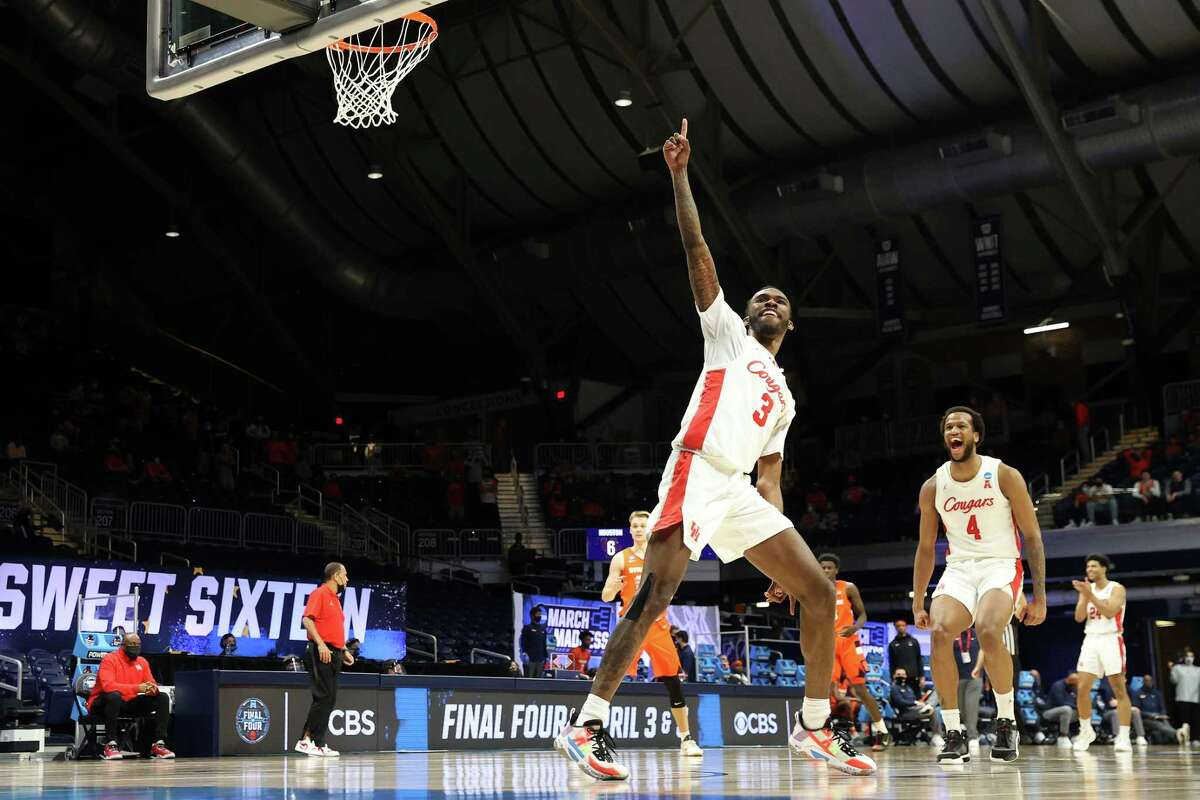INDIANAPOLIS, INDIANA - MARCH 27: DeJon Jarreau #3 of the Houston Cougars reacts after a play against the Syracuse Orange in the second half of their Sweet Sixteen game of the 2021 NCAA Men's Basketball Tournament at Hinkle Fieldhouse on March 27, 2021 in Indianapolis, Indiana.
