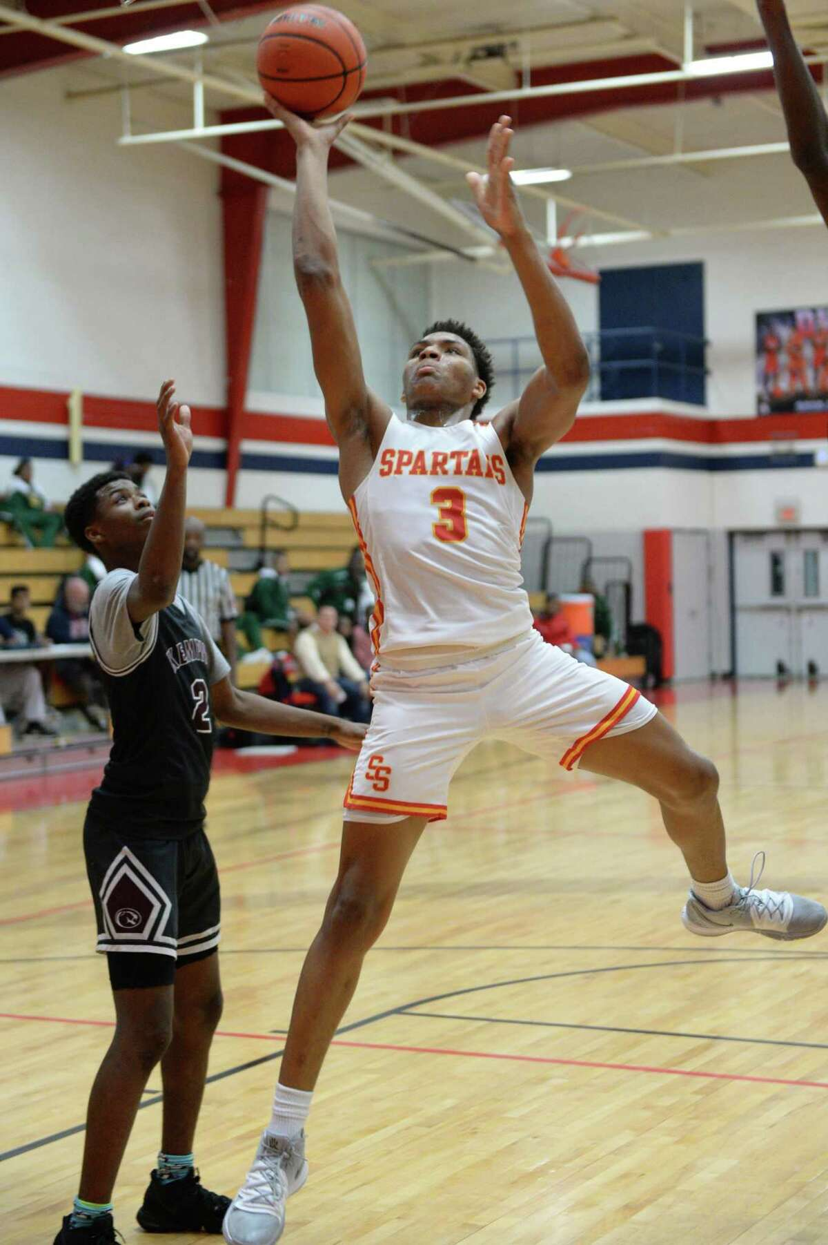 Z'Corrian Haynes (3) of Stafford attempts a shot during pool play of the Fort Bend ISD Invitational Boys Basketball Tournament between the Kempner Cougars and the Stafford Spartans on Thursday, December 12, 2019 at Dulles HS, Sugar Land, TX.