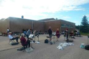In this file photo, the Manistee Community Band prepares to rehearse at the Armory Youth Project in August 2020. This year, the band's first rehearsal is slated for May 18 at 7 p.m. Anyone interested in joining can reach out via email to Manisteecommunityband@gmail.com.