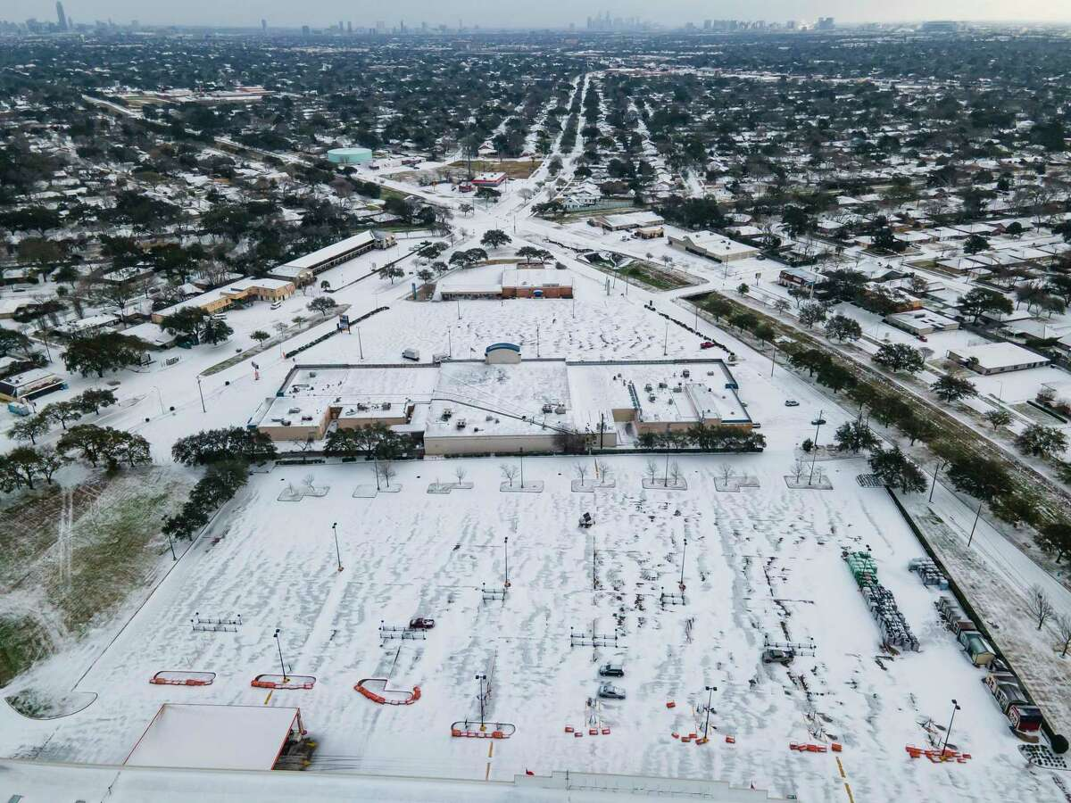 A Home Depot parking lot is covered in snow in the Westbury neighborhood, Monday, Feb. 15, 2021, in Houston.