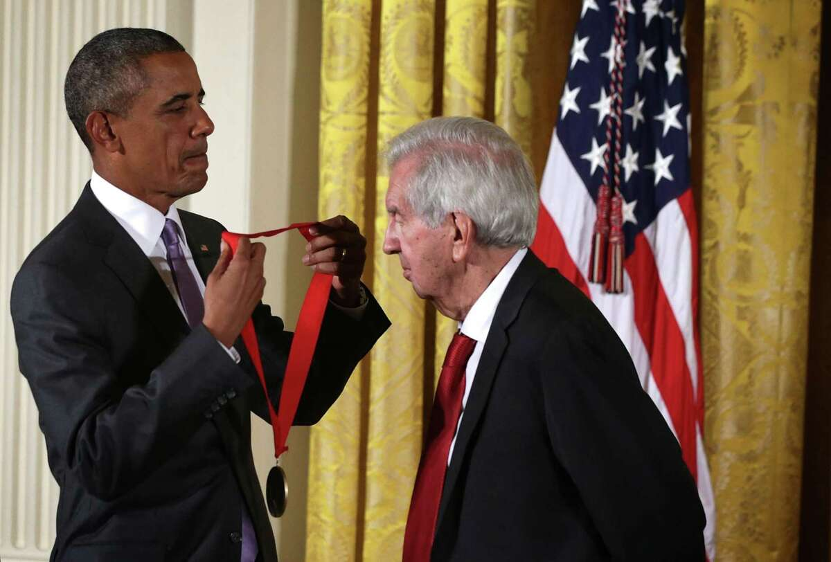 Then-President Barack Obama presents the 2014 National Humanities Medal to Larry McMurtry during an East Room ceremony at the White House on Sept. 10, 2015, in Washington, D.C. Larry McMurtry was honored for his books, essays and screenplays. (Alex Wong/Getty Images/TNS)