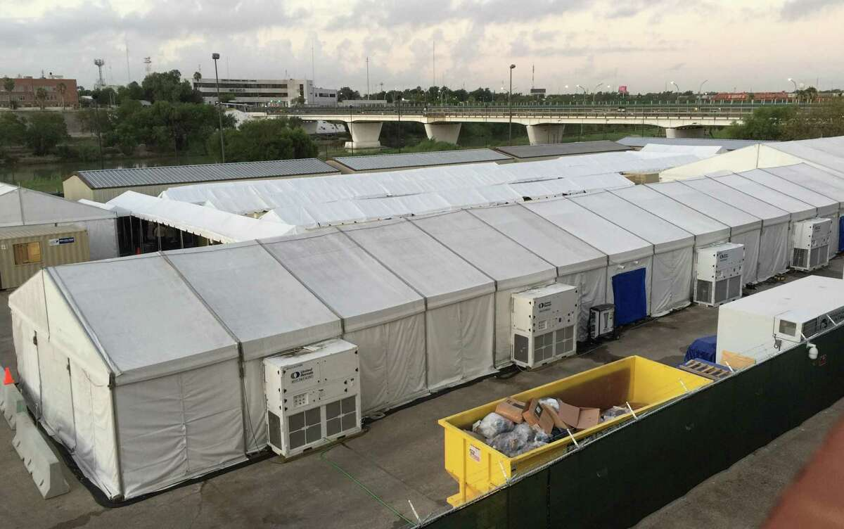 Shown are the tents set up in Laredo where, before the pandemic, migrants seeking asylum were taken for a court hearing through live video stream with an immigration judge in San Antonio.