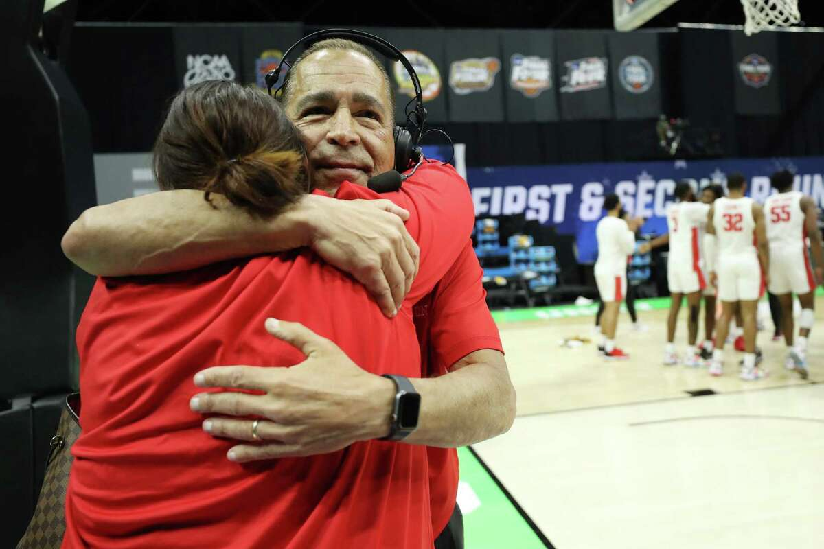 Kelvin Sampson shares a moment with his daughter Lauren after the team's win over Rutgers.