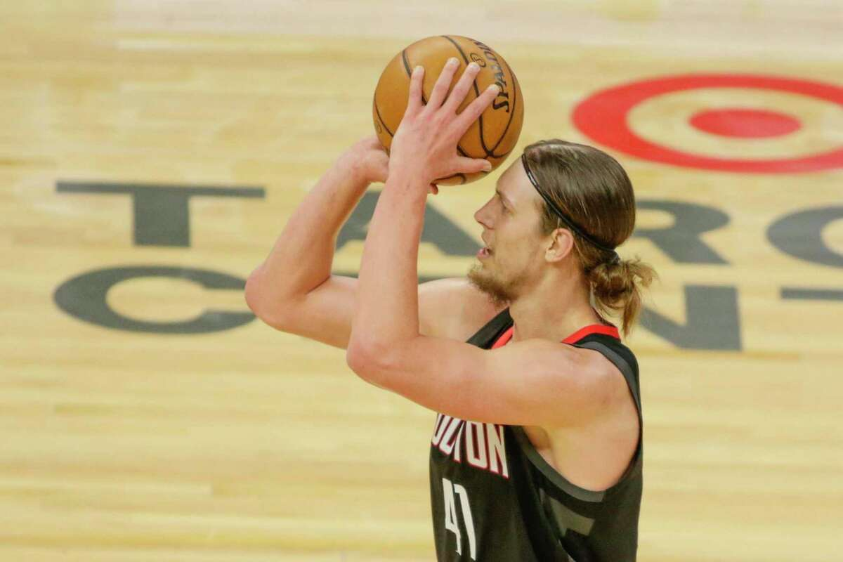 Rockets center Kelly Olynyk shoots against the Minnesota Timberwolves in his debut for Houston on Saturday.