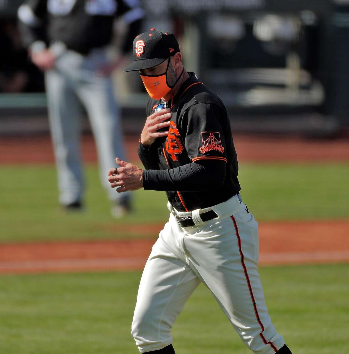 Giants manager Gabe Kapler jogs back to the dugout after a pitching change in the sixth inning as the San Francisco Giants played the Chicago White Sox in a spring training game at Scottsdale Stadium in Scottsdale, Ariz., on Thursday, March 4, 2021.