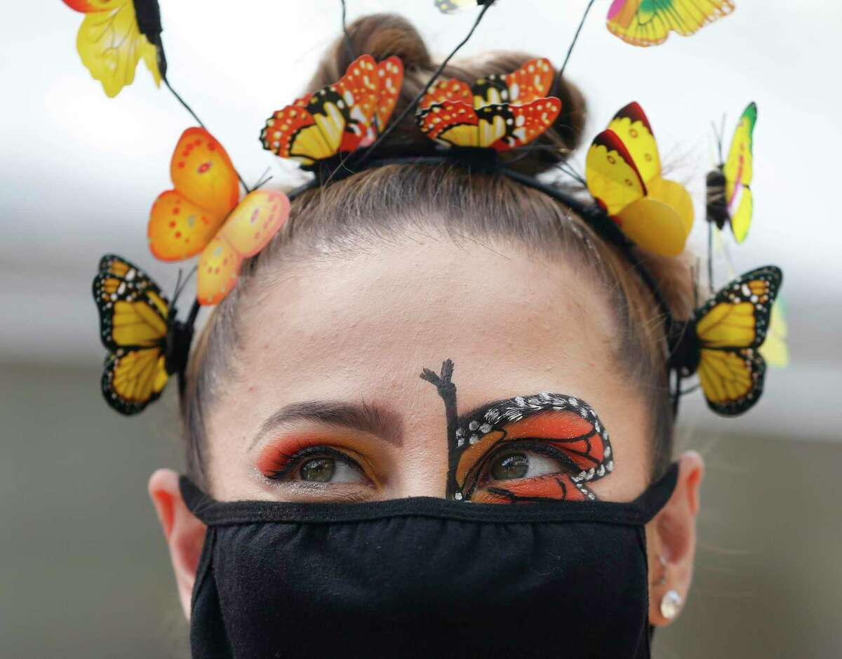 Tori Estrada dressed up as a butterfly for photos with patrons at the San Antonio Zoo's Monarch Fest, a two-day celebration of the monarch butterfly. The event wrapped Sunday.