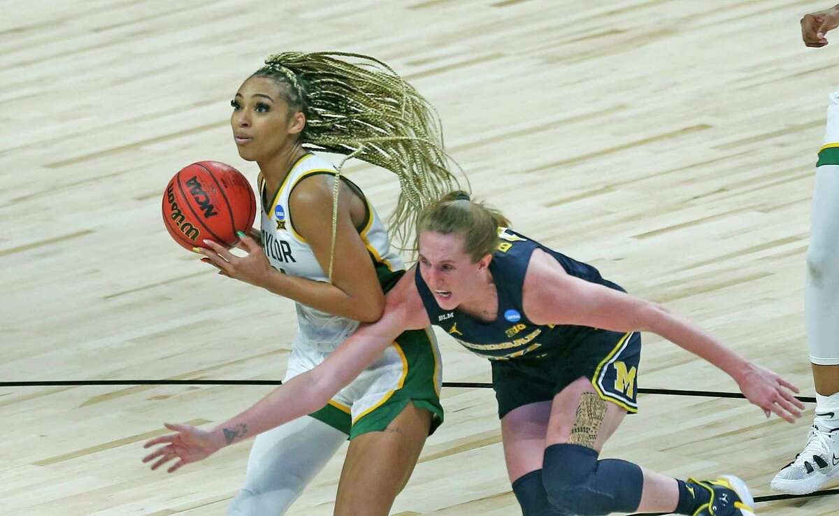 Baylor guard Dijonai Carrington (21) steals the ball from Michigan guard Leigha Brown (32). Baylor defeated Michigan 78-75 in OT on Saturday, March 27, 2021 at the Alamodome.