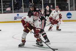 Boston College's Trevor Kuntar skates with the puck after St. Cloud State defenseman Seamus Donohue loses his stick in the NCAA hockey Albany Regional championship game Sunday, March 28, 2021, at Times Union Center. (Robert Simmons/Times Union Center)