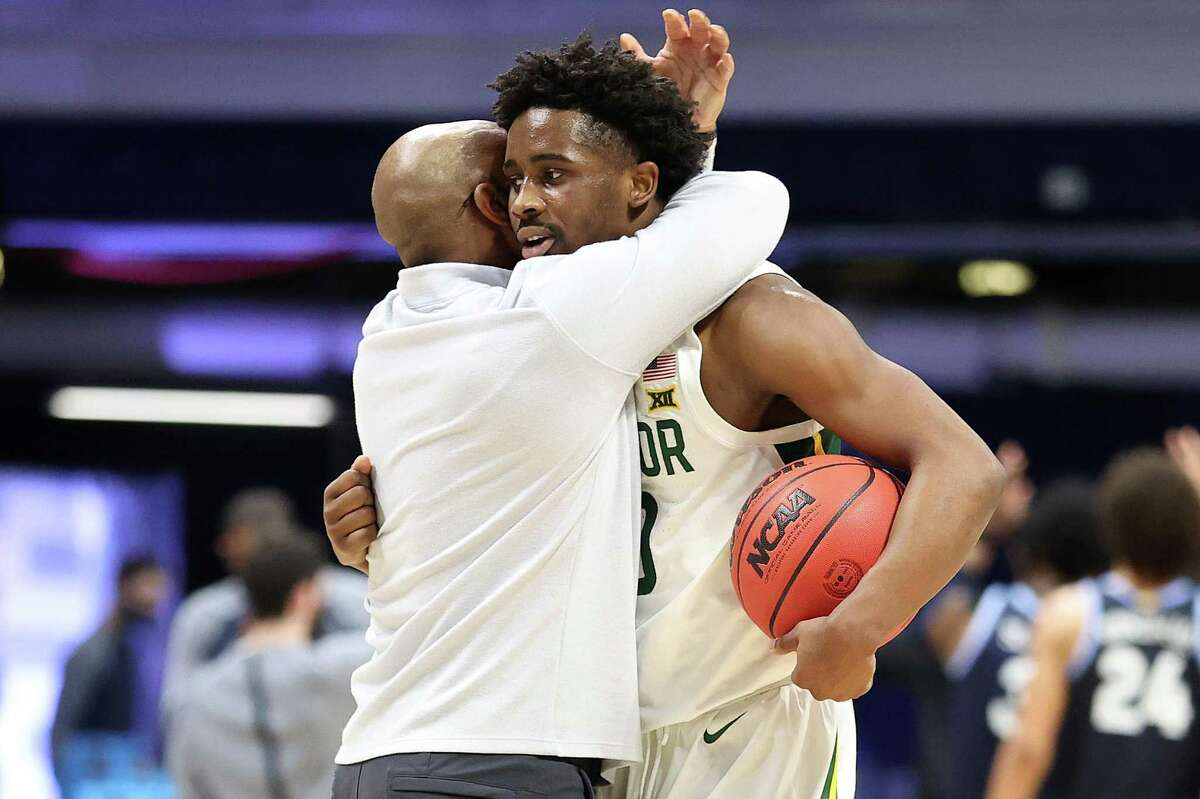 INDIANAPOLIS, INDIANA - MARCH 27: Adam Flagler #10 of the Baylor Bears celebrates after their Sweet Sixteen win over the Villanova Wildcats in the 2021 NCAA Men's Basketball Tournament at Hinkle Fieldhouse on March 27, 2021 in Indianapolis, Indiana. (Photo by Andy Lyons/Getty Images)