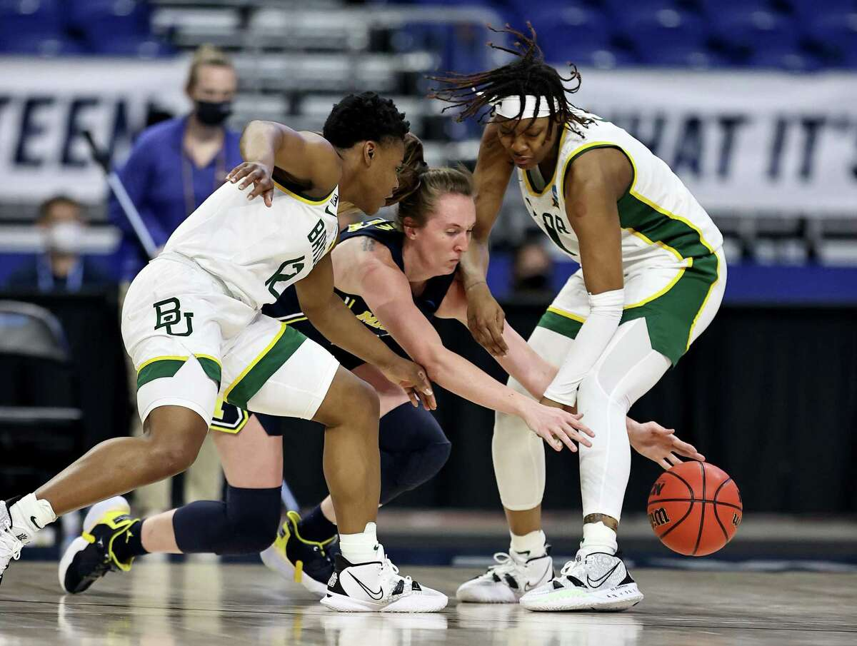 Baylor's Moon Ursin, left, and NaLyssa Smith, right, double team a Michigan player during their win on Saturday.