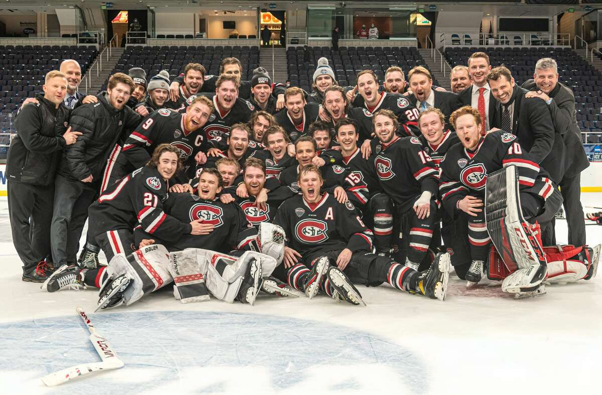 The St. Cloud State hockey team poses for a team photo after winning the NCAA hockey Albany Regional championship game Sunday, March 28, 2021, at Times Union Center. The Huskies defeated Boston College, 4-1. (Robert Simmons/Times Union Center)