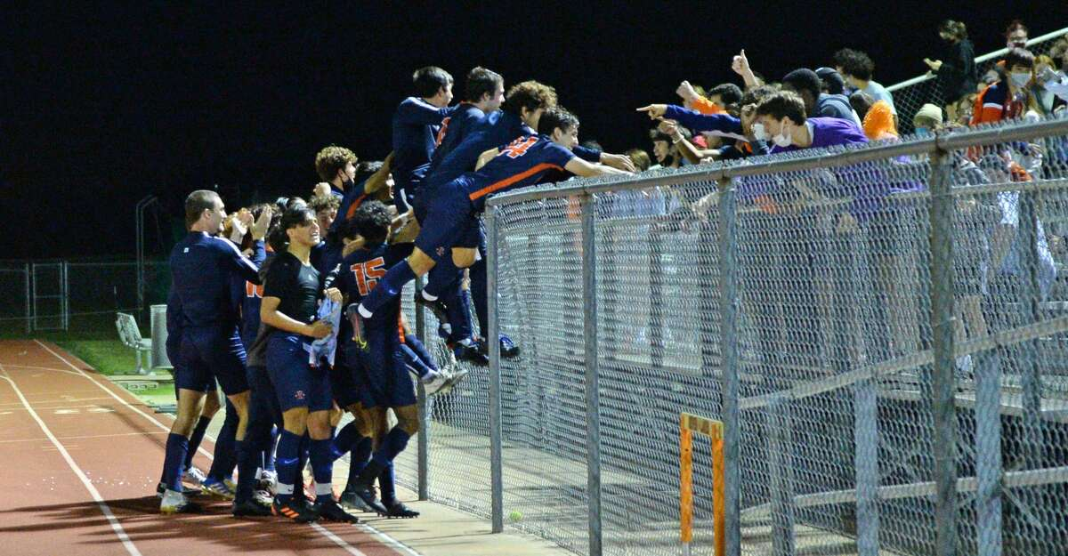 The Seven Lakes Spartans celebrate with their fans following their 2-1 victory over the Cinco Ranch Cougars in the 6A-III District 19 Championship soccer match on Friday, March 12, 2021 at Seven Lakes HS, Katy, TX.