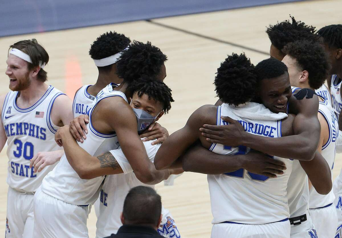 FRISCO, TEXAS - MARCH 28: DeAndre Williams #12 and Boogie Ellis #5 of the Memphis Tigers celebrate after defeating the Mississippi State Bulldogs during the second half of the 2021 NIT Championship at Comerica Center on March 28, 2021 in Frisco, Texas. (Photo by Ronald Martinez/Getty Images)