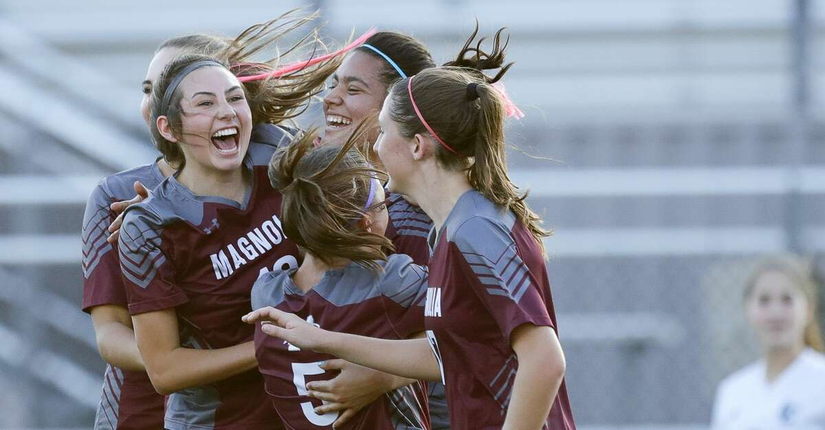 Magnolia players celebrate after Gaby Palomino's header tied the match 1-1 during the first period of a bi-district high school soccer match, Friday, March 26, 2021, in Waller.