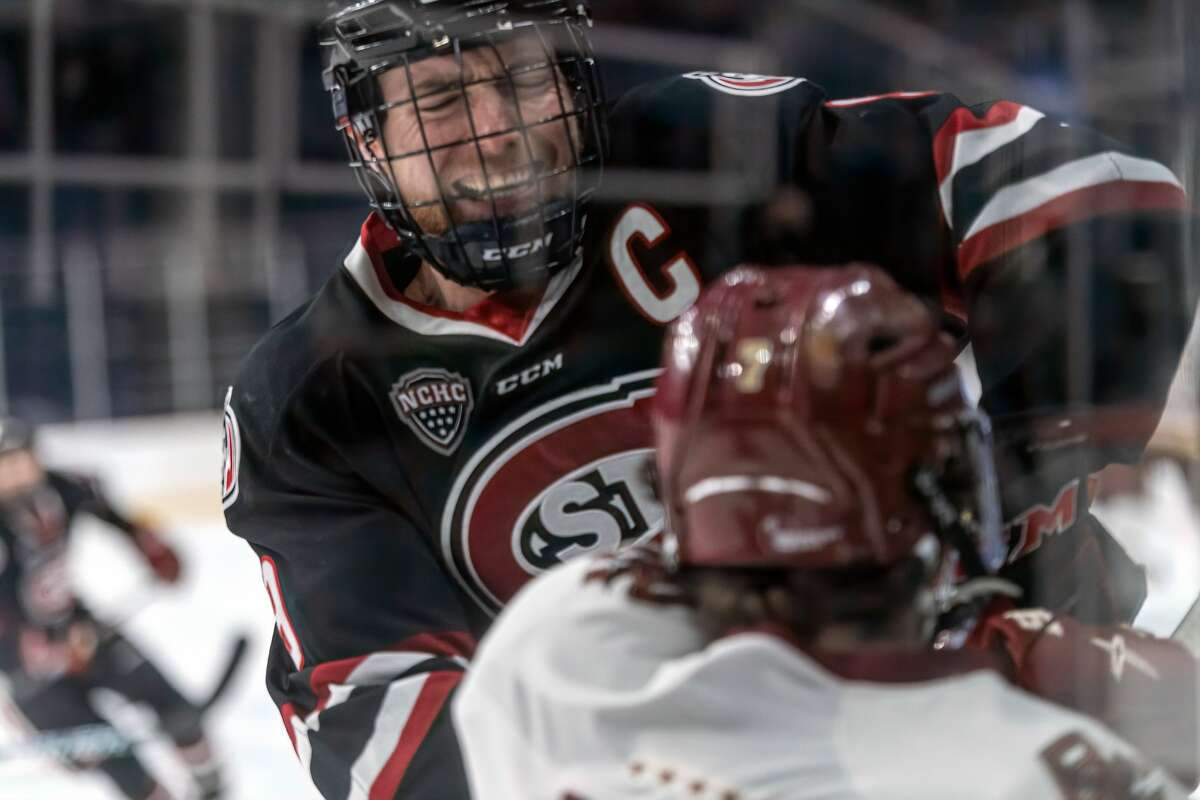St. Cloud State captain Spencer Meier checks Boston College's Eamon Powell into the boards in the NCAA hockey Albany Regional championship game Sunday, March 28, 2021, at Times Union Center. St. Cloud defeated BC 4-1 to advance to the Frozen Four in Pittsburgh. (Robert Simmons/Times Union Center)