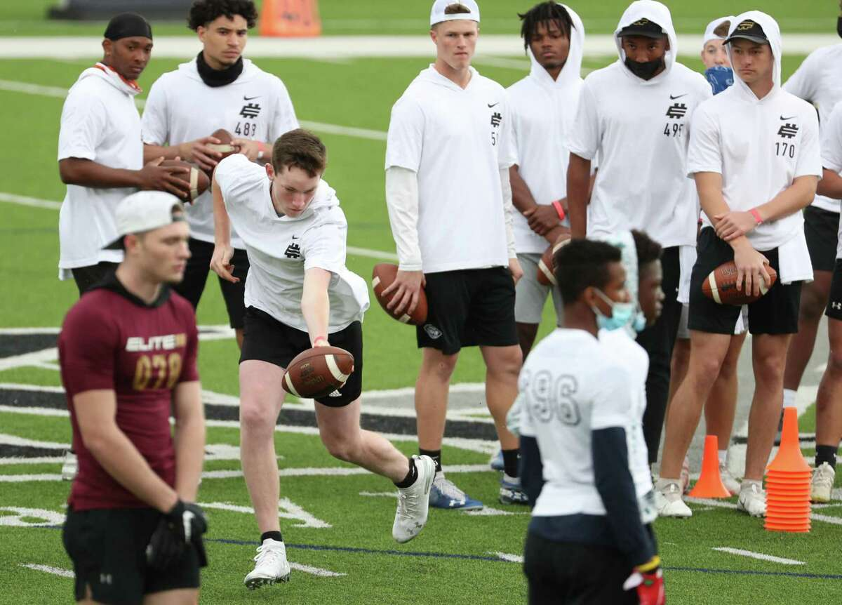 Christian Arceneaux, of South Terrebonne (La.), fakes a handoff during a workout at the Elite 11 quarterback showcase regional at Legacy Stadium Sunday, March 28, 2021 in Katy.