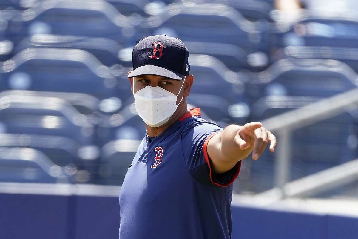 Boston Red Sox manager Alex Cora is shown before a spring training baseball game against the Tampa Bay Rays Friday, March 26, 2021, in Port Charlotte, Fla. (AP Photo/John Bazemore)