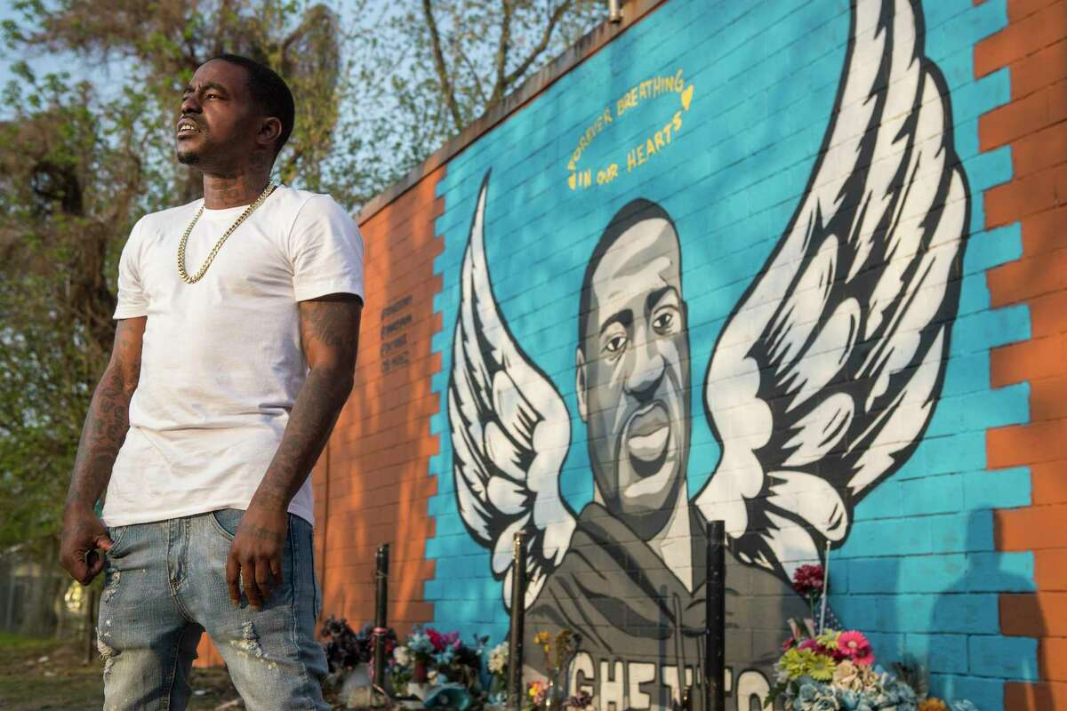 Rap artist Cal Wayne poses for a portrait at the George Floyd memorial mural in 3rd Ward Friday, March 26, 2021 in Houston. Wayne said he expects to be in Minneapolis for the trial of former Minneapolis police officer Derek Chauvin, who was charged with murder in Floyd's death. for up to five days to show his support.