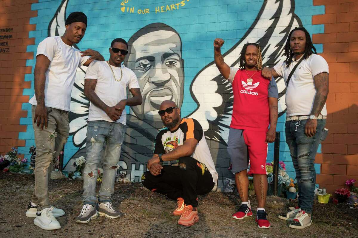Kendrick Warren, far left, Cal Wayne, Chaz Hutchins, Terrence Fontenot and Leonard McGowan pose for a portrait at the George Floyd memorial mural in 3rd Ward Friday, March 26, 2021 in Houston. Wayne said he expects to be in Minneapolis for the trial of former Minneapolis police officer Derek Chauvin, who was charged with murder in Floyd's death. for up to five days to show his support..