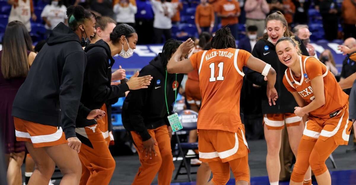 The Texas Longhorns celebrate their win over the Maryland Terrapins 64-61 in the Sweet Sixteen round of the NCAA Women's Basketball Tournament at the Alamodome on March 28, 2021 in San Antonio, Texas. (Photo by Carmen Mandato/Getty Images)