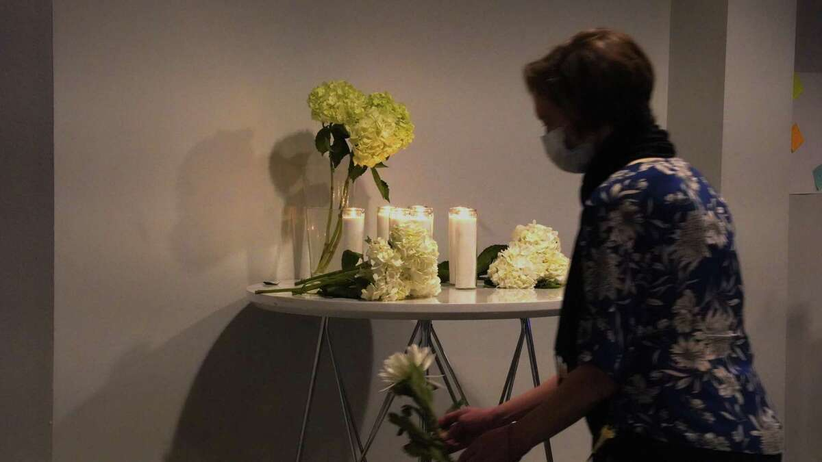 A candlelight vigil in Houston remembers the victims of the deadly Atlanta spa shootings on Sunday, March 29, 2021.