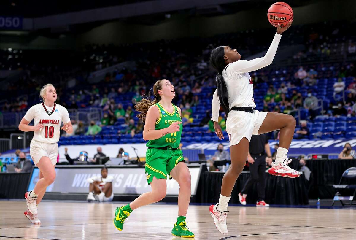 Dana Evans #1 of the Louisville Cardinals drives to the basket ahead of Taylor Mikesell #11 of the Oregon Ducks during the second half in the Sweet Sixteen round of the NCAA Women's Basketball Tournament at the Alamodome on March 28, 2021 in San Antonio, Texas.