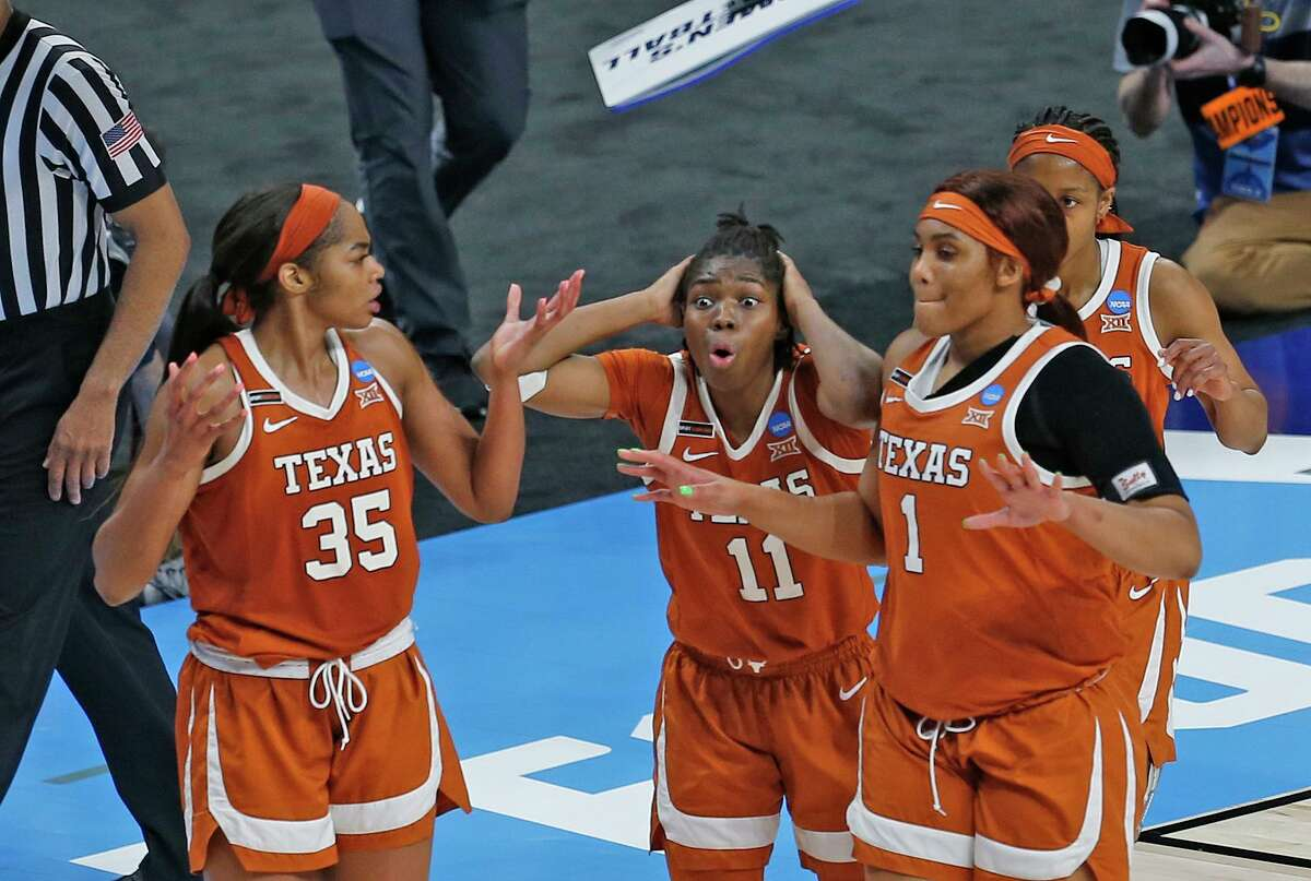 Texas guard Joanne Allen-Taylor (11),Texas forward Charlie Collier (35) and Texas forward Lauren Ebo (1) can't believe the call in the second half on Sunday, March 28, 2021 at the Alamodome. Texas defeated Maryland 64-61