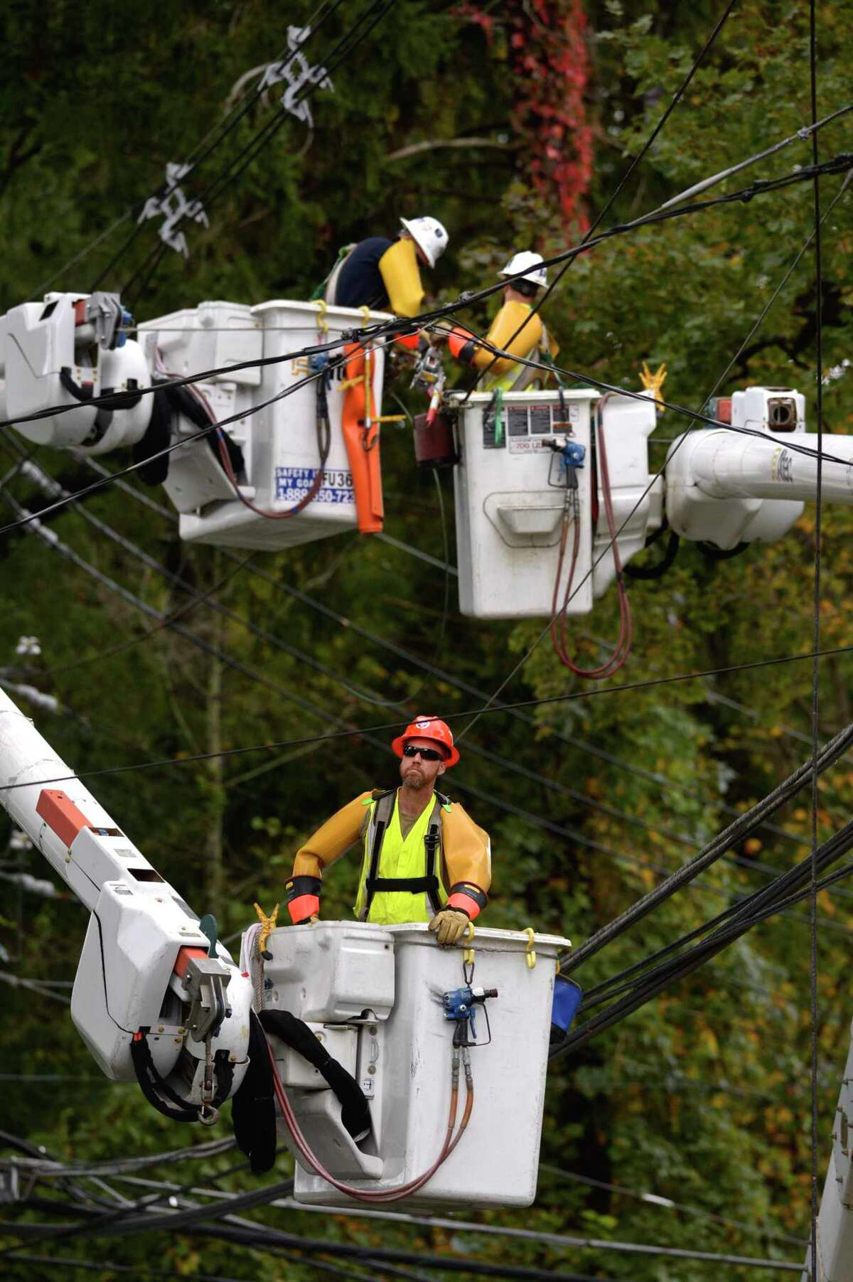 Crews work on downed power lines on South Street, at Oakland Heights, in Bethel, Conn, on Wednesday, September 30, 2020. Power was out in multiple locations due to a storm that moved through the area overnight.