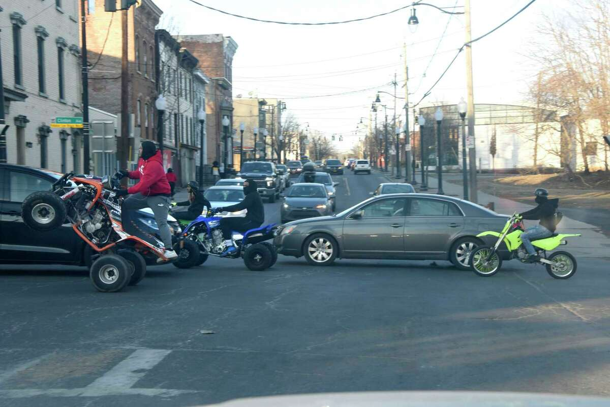 Dirt bikes and ATV's are seen weaving through traffic at an intersection of Henry Johnson Blvd. on Wednesday, March 10, 2021 in Albany, N.Y. (Lori Van Buren/Times Union)