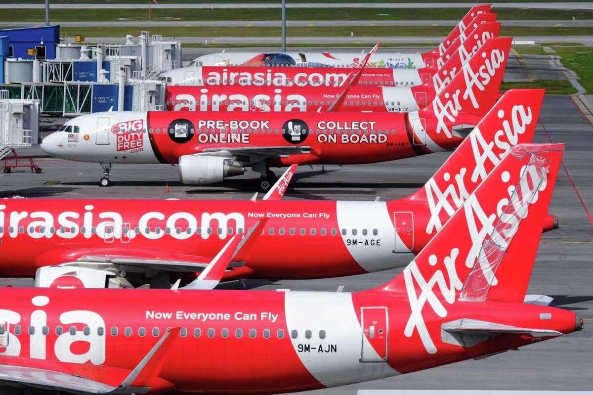 AirAsia Group aircraft stand on the tarmac at Kuala Lumpur International Airport 2 (KLIA 2) in Sepang, Selangor, Malaysia, on Monday, Aug. 24, 2020.