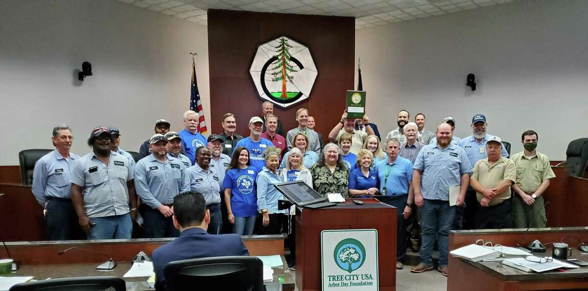 Members of the Conroe Parks Department, Root for Conroe and the Montgomery County Beautification Committee gathered at the Thursday Conroe City Council meeting to celebrate the city's designation as a Tree City USA from the National Arbor Foundation.