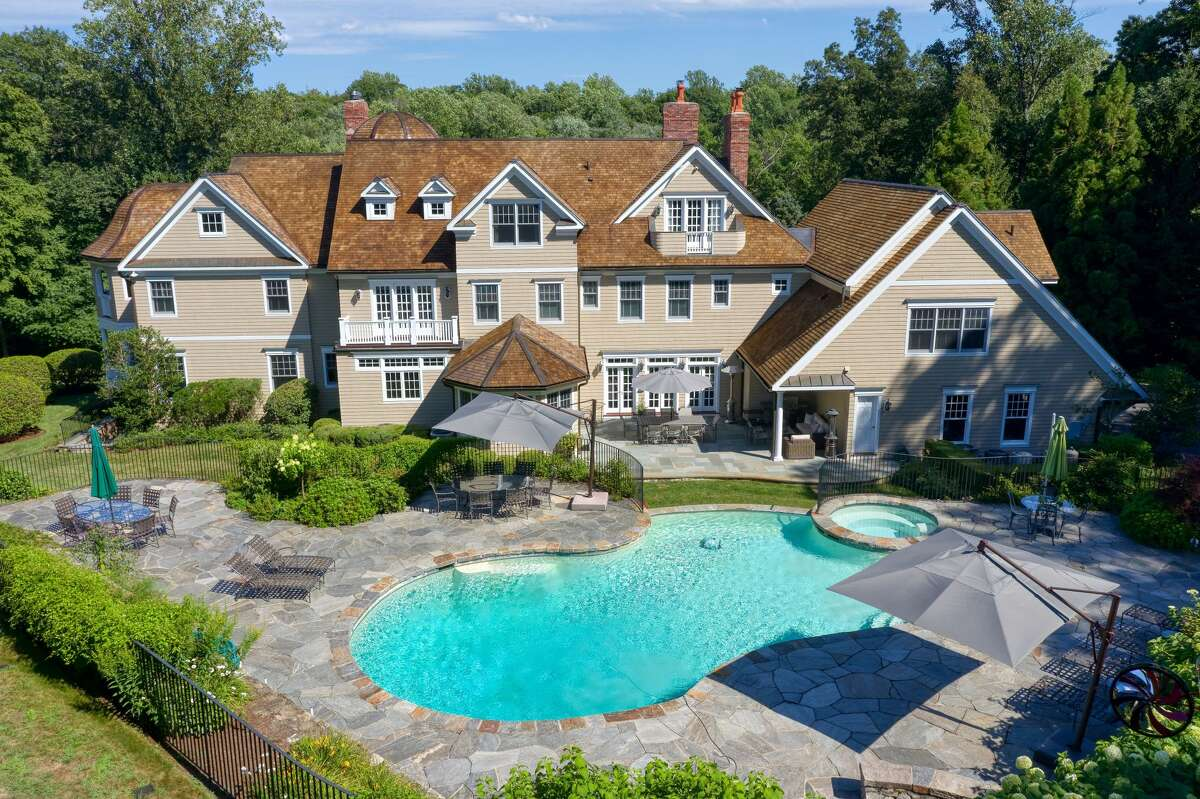 Rear yard with free-form pool at 1196 Smith Ridge Road, New Canaan.