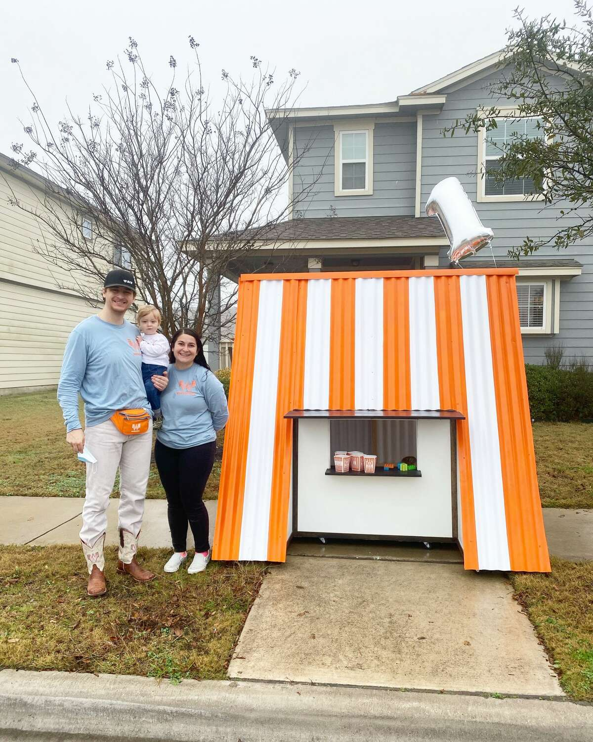 Danae and Ian Klingspor from Pflugerville (Northeast of Austin) build a more than 6-foot Whataburger playhouse for their baby's first birthday on Jan. 24.
