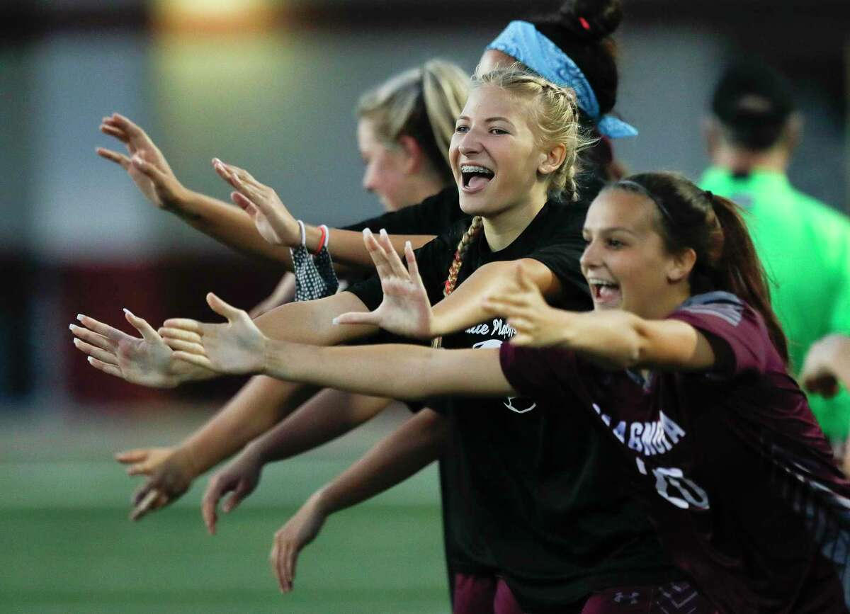 Magnolia's Tory Sims, second from right, celebrates after Sara Giannotti's first of three goals during the second period of a bi-district high school soccer match, Friday, March 26, 2021, in Waller.