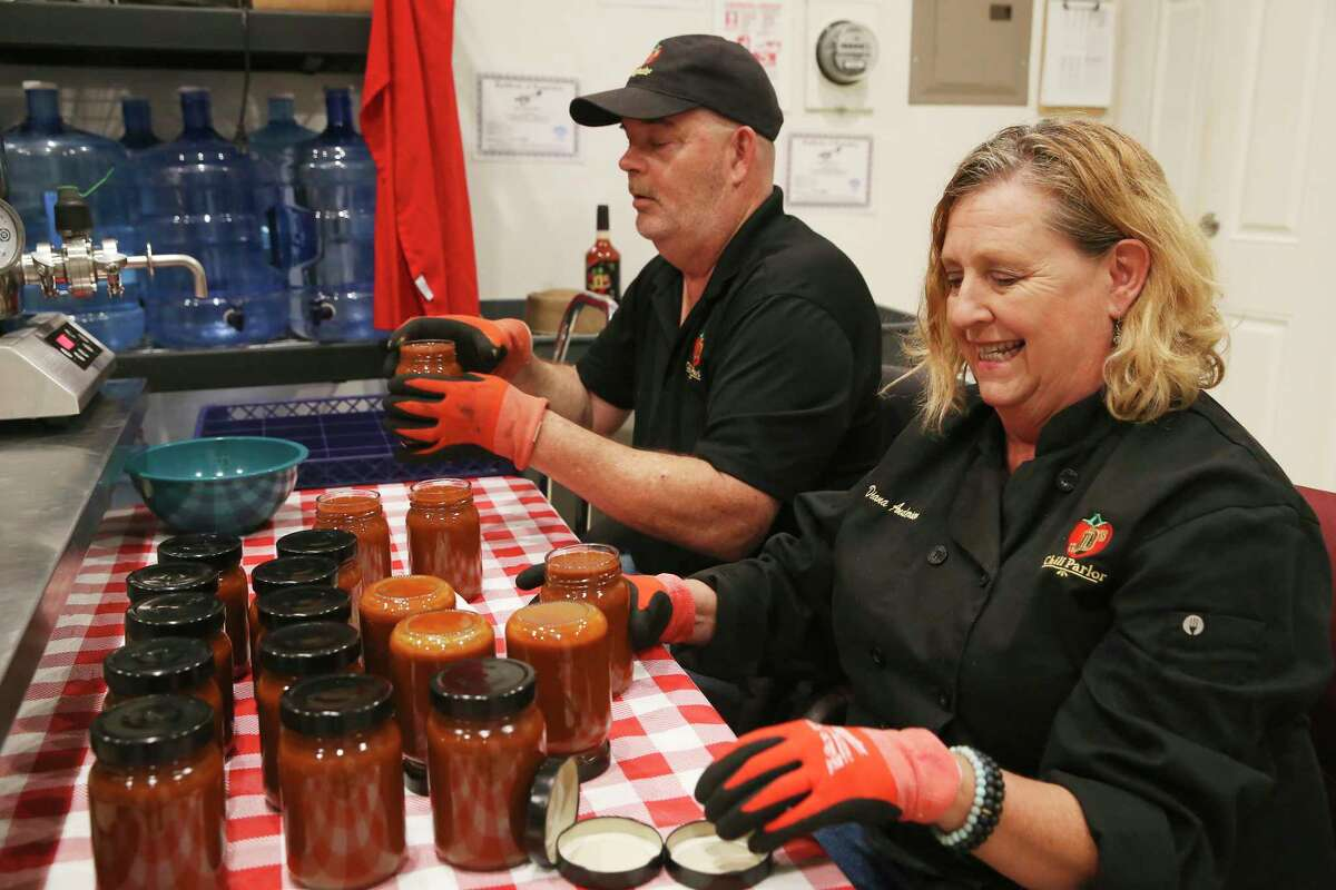 John and Diana Anderson bottle their original chili mix at their company's, JD's Chili Parlor kitchen in the Local Sprout Food Hub.