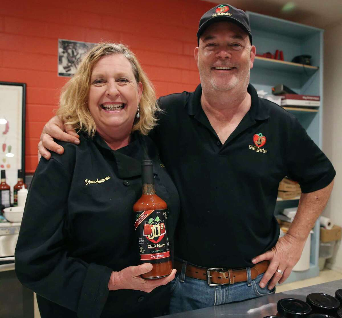 Diana and John Anderson pose with their Chili Mary mix at the company's kitchen in the Local Sprout Food Hub. It comes in multiple flavors and just needs vodka or tequila added to it.