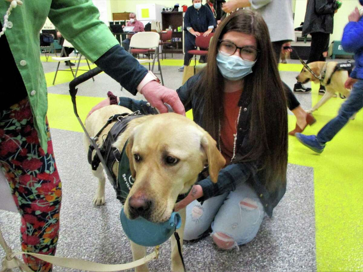 Trainer Jessica Fitzgerald says goodbye to service dog Vega, who is on the way to Hawaii.