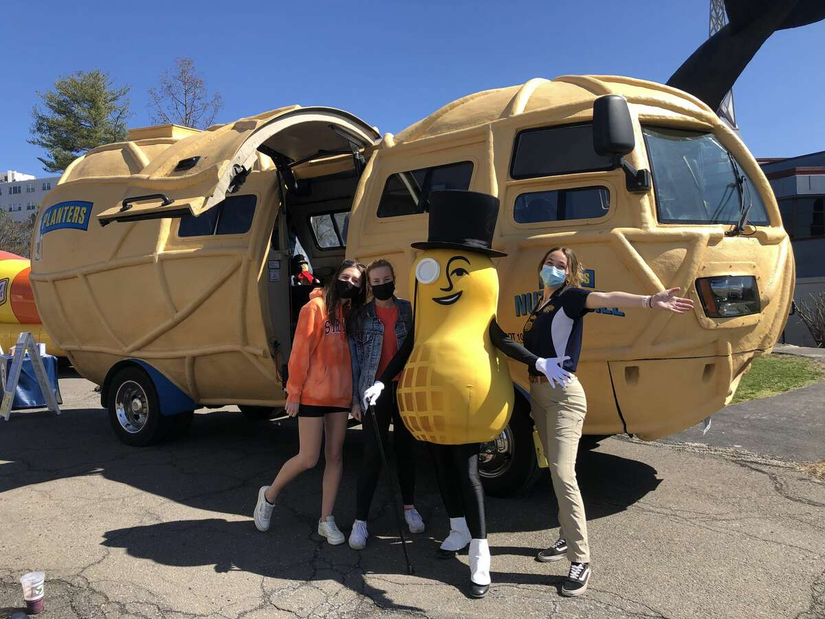 The Oscar Mayer Wienermobile and the Planters NUTmobile, a legume-shaped vehicle, stopped at the Children's Museum in West Hartford on March 27.