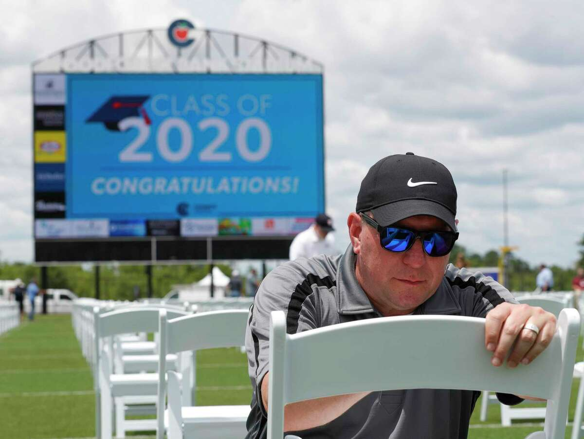 Conroe ISD Superintendent Curtis Null places sticker to help students find their seat at Woodforest Bank Stadium, Friday, May 29, 2020, in Shenandoah.